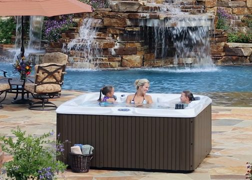 a mother and children having family fun in a hot tub